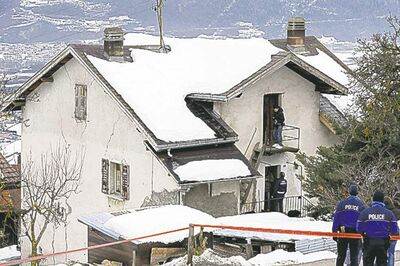 Laurent Gillieron / The Associated PressPolice investigate the house of the gunman and the scene after a shooting in Daillon, Switzerland, Thursday.