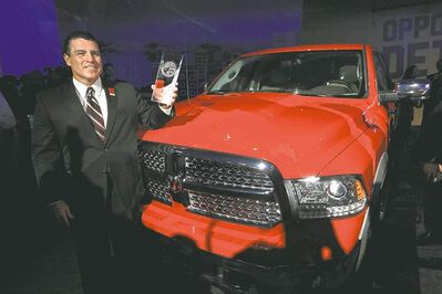 Fred Diaz, president and CEO of Ram truck, stands with the Ram 1500 after the vehicle was awarded the North American Truck of the Year at the Detroit auto show.