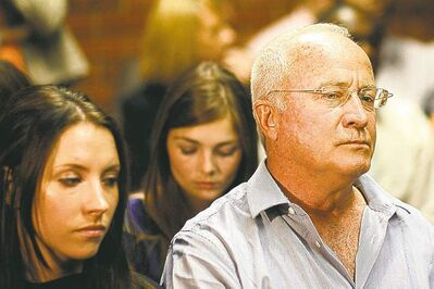 Themba Hadebe / The Associated PressOscar Pistorius�s father Henke Pistorius and sister Aimee look on during his  bail hearing in Pretoria, South Africa, Thursday.