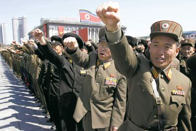 Jon Chol Jin / The Associated PressNorth Korean army officers chant slogans during a rally at Kim Il Sung Square Friday.