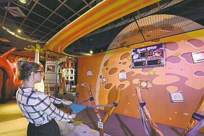 Mini-Angry Birds are launched in a slingshot to zap space pigs at the Kennedy Space Center Visitor Complex. The online game Angry Birds is the inspiration for the new attraction at the space center, where most of the exhibits focus on space exploration and NASA history.