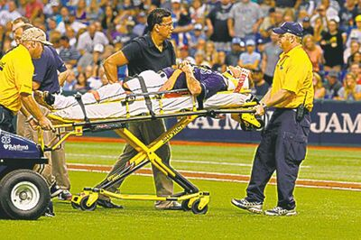 Rays pitcher Alex Cobb is rolled out on a stretcher after being hit in the head.