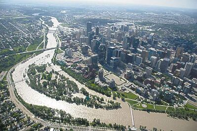 A flooded downtown Calgary is seen from a aerial view of the city Saturday, June 22, 2013. THE CANADIAN PRESS/Jonathan Hayward