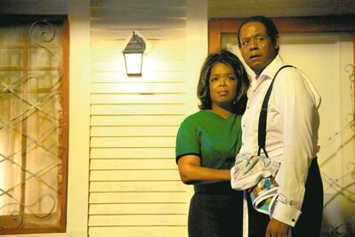 This film image released by The Weinstein Company shows Oprah Winfrey as Gloria Gaines and Forest Whitaker as Cecil Gaines in a scene from Lee Daniels' The Butler.