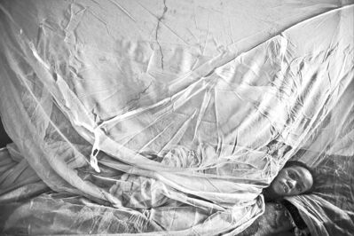 A woman suffering from malaria rests in a hospital in North Darfur, Sudan, on May 13.
