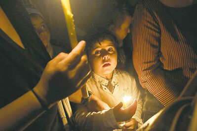Luca Bruno / The Associated PressA child holds a candle during a torch light procession in the island of Lampedusa, Italy, Friday. A ship carrying African migrants toward Italy caught fire and capsized off the Sicilian island of Lampedusa Thursday, spilling hundreds of passengers into the sea, officials said. The scope of the tragedy at Lampedusa, with 111 bodies recovered so far, 155 people rescued and up to an estimated 250 still missing, according to officials, prompted outpourings of grief and demands for a comprehensive European Union immigration policy to deal with the tens of thousands of migrants fleeing poverty and strife in Africa and the Middle East.