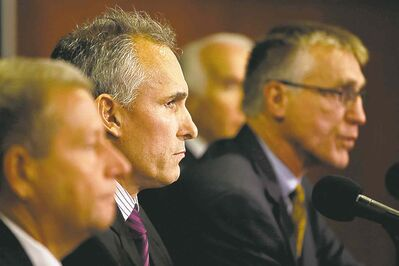 Craig Berube (second from left) is introduced as the new Flyers head coach Monday.