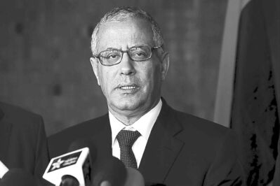 Libya�s Prime Minister Ali Zidan speaks to the media during a news conference in Rabat, Morocco on Tuesday, Oct. 8, 2013. Zidan was snatched by gunmen before dawn Thursday from a Tripoli hotel where he resides, the government said. (Abdeljalil Bounhar / The Associated Press)