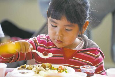 Jamie Beardy, 4, enjoys her meal at Siloam. 