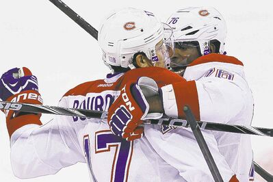 Montreal Canadiens P.K. Subban (right)  and Rene Bourque celebrate  Subban�s goal during the first period.