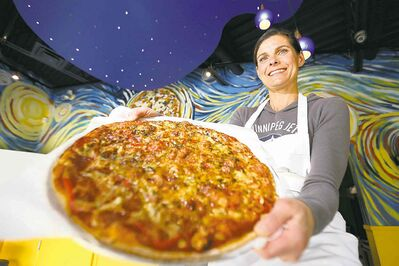 TREVOR HAGAN / WINNIPEG FREE PRESS Elizabeth Wagner, owner of Van Goes Pizza, shows off the �Starry Night� pizza, one of their masterpieces.
