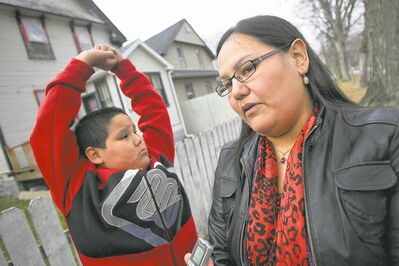 Maria Starr, with son Elrond, dislikes the disruption caused by party houses on her North End street. The province wants to give police the power to shut them down.