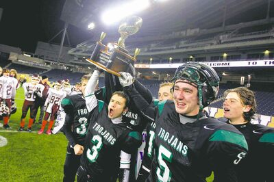 Vincent Massey's Matthew Lemay (3) and linebacker Ryan Crocker (5) hoist the WHSFL junior varsity trophy Thursday night.
