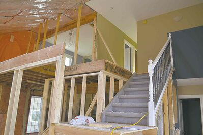 A stairway in the original house will be diverted to allow room for a new part of the home that will include an extensive kitchen.
