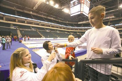 Ruth Bonneville / Winnipeg Free PressJennifer Jones took time to sign an autograph for a young curling fan following Saturday�s practice session at the MTS Centre.