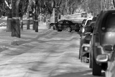 single vehicle car into tree  on an icy rutted , unsanded  Overdale St. -Last weeks snow fall  has  left pack snow and ice  rut hazards to traffic. The city has chosen not to scrape the streets to the pavement .  Dec. 9 2013 / KEN GIGLIOTTI / WINNIPEG FREE PRESS