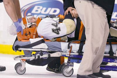 Michael Dwyer / the associated press archivesPittsburgh Penguins� Brooks Orpik is taken off the ice after being set upon by Bruins tough guy Shawn Thornton in a game in Boston on Dec. 7.