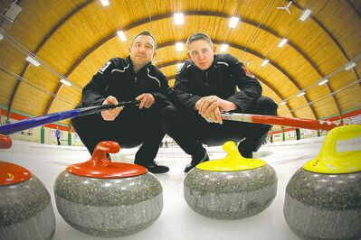 Skip Justin Stanus (left) and third Josh Drews finally caught some breaks, and a berth in the provincials.