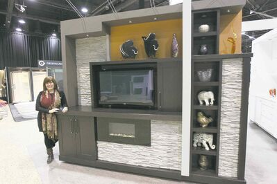 Jan Currier checks out Urban Effects by Norcroft Cabinetry.