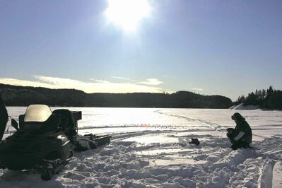 Heavy snow makes getting around on the ice difficult without a snowmobile -- but the fishing is worth it.