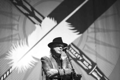 Neil Young speaks to reporters before the last concert in his Honour the Treaties tour.