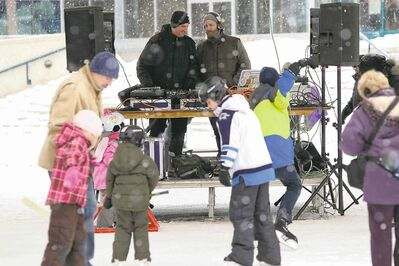 DJ Co-op (left) and DJ Hunnicutt (right) perform for skaters under the canopy at The Forks Sunday afternoon. 140119 - January 19, 2014 MIKE DEAL / WINNIPEG FREE PRESS