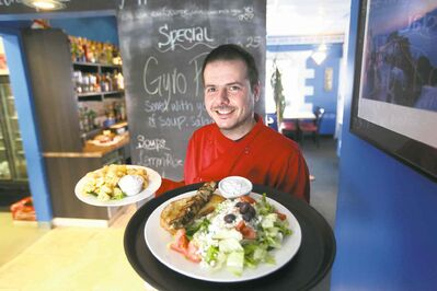 Andrew Spiridakos serves the house specialities, chicken souvlaki and squid at the Olympia.
