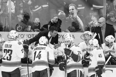 John Woods / the canadian pressJets fans taunt the Canucks with an image of their head coach John Tortorella during the first period Friday. On Jan. 20, Tortorella was suspended 15 days by the NHL.