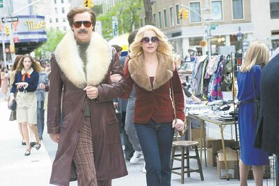 Will Ferrell and Christina Applegate in Anchorman 2: The Legend Continues.