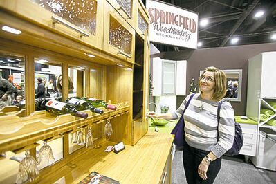 Patti Dola looks at a kitchen display.