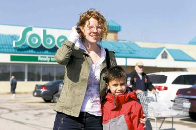 Ruth Bonneville / Winnipeg Free Press  Michelle Lagadi, with her son, Ethan, said she won't avoid potential transmission settings such as the Sobeys on Dakota Street.