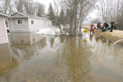 Water is pumped out from a property on Patricia Drive along Netley Creek Wednesday. (This was one of four properties that frequently gather water in the spring time.) There is no water damage to any of the homes. Wayne Glowacki / Winnipeg Free Press April 23   2014