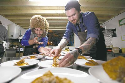 Chefs Mandel Hitzer (left) and Adam Donnelly prepare appetizers at RAW:almond at The Forks.