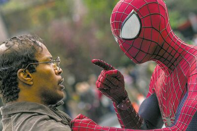 "This image released by Sony Pictures shows Jamie Foxx, left, and Andrew Garfield as Spider-Man in ""The Amazing Spider-Man 2."" (AP Photo/Columbia Pictures - Sony Pictures, Niko Tavernise)"