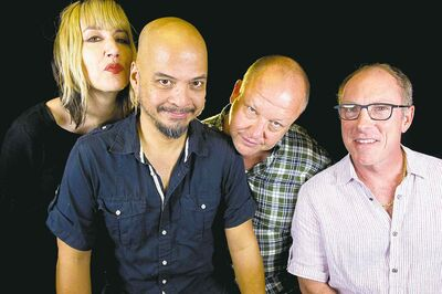 "In this Friday, Sept. 20, 2013 photo, rock band The Pixies, from left, Kim Shattuck, Joey Santiago, Black Francis and David Lovering, pose for a portrait in New York. In late June 2013, a video for a new song, ""Bagboy,"" showed up online unannounced. A few weeks later, the band again surprised fans with an online collection of four new songs released under the name �EP-1� along with a global tour announcement. (Photo by Diane Bondareff/Invision/AP)"