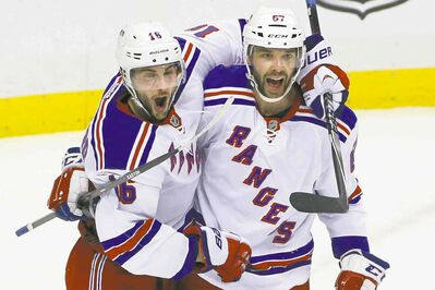 It was a fun-filled night for the New York Rangers. Here, Derick Brassard (16) celebrates his first-period goal with Benoit Pouliot.