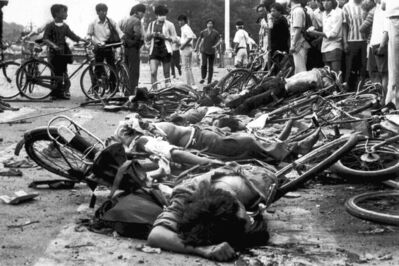 The bodies of civilians lie among mangled bicycles near Beijing's Tiananmen Square early June 4, 1989. Tanks and soldiers stormed the area, bringing a violent end to student demonstrations for democratic reform in China.