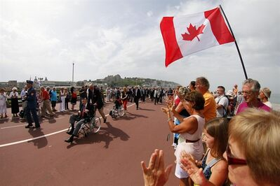 "Spectators look on as veterans during the commemorations to honor Allied soldiers killed 70-years ago in a failed World War II invasion, take place in front the sea, in Dieppe, northern France, Sunday Aug. 19, 2012. Some 1,400 soldiers were killed in ""Operation Jubilee"" when the Allies tried to briefly invade Dieppe to test German defenses. (AP Photo/Michel Spingler)"
