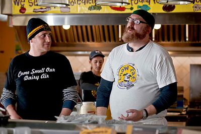 In The Five Year Engagement, Jason Segel, left, and Brian Posehn work  the sandwich line at Ann Arbor's  Zingerman's Deli.