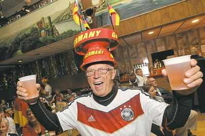Irv Koch cheers Germany�s World Cup win with his festive, patriotic hat at the German Society of Winnipeg Sunday.