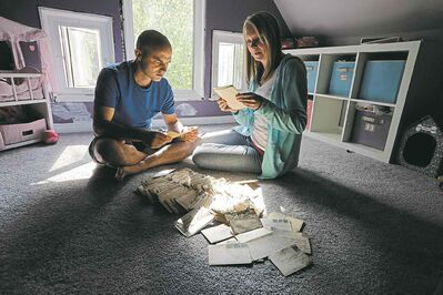 KEN GIGLIOTTI / WINNIPEG FREE PRESS Lori and Darrell Lafond discovered 100 love  letters hidden under the floorboards of their home during a renovation. The letters are from a First World War soldier to his girlfriend, whom he later married.
