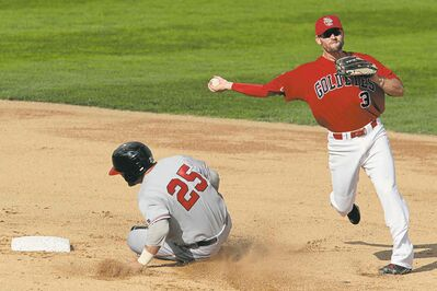 The Goldeyes' Tyler Kuhn (3) throws for the double-play as he gets Fargo-Moorhead RedHawks Ronnie Bourquin (25) out at second.