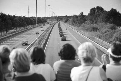 Phil Nijhuis / the associated pressPeople watch a convoy of hearses bearing the remains of passengers and crew killed in the downing of Malaysia Airlines Flight 17 as it made its way along a highway near Boxtel, Netherlands, on Thursday.