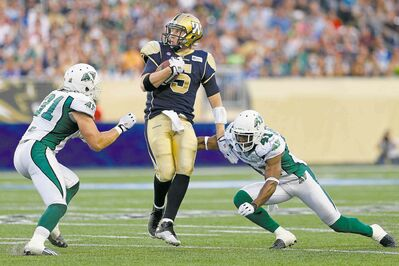 John Woods / THE CANADIAN PRESS files Winnipeg Blue Bombers quarterback Drew Willy was facing steady pressure from Saskatchewan defenders Thursday night at Investors Group Field.