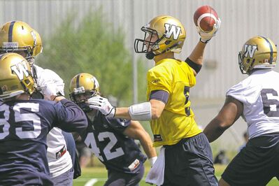 MIKE DEAL / WINNIPEG FREE PRESS The often unprotected Drew Willy fires a pass during Sunday�s workout. The QB and his Blue and Gold teammates are back in action Tuesday in Toronto.