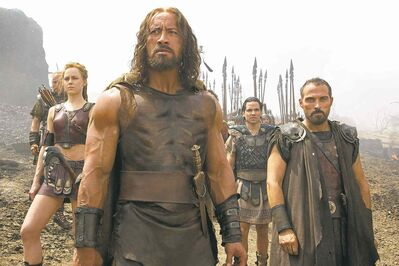 """From left, Aksel Hennie as Tydeus, Ingrid Berdal as Atalanta, Dwayne Johnson as Hercules, Reece Ritchie as Iolaus, and Rufus Sewell as Autolycus in a scene from """"Hercules."""""""