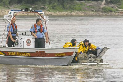 Tina Fontaine's body is pulled from the Red River Sunday.