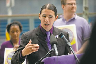 Robert-Falcon Ouellette outside of the newly constructed police headquarters.