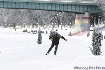 Rick Shore  skates along the Assiniboine River trail.