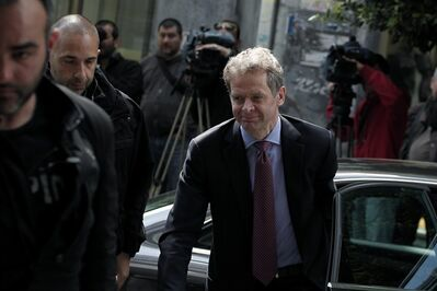 International Monetary Fund (IMF) mission chief Poul Thomsen, right, arrives for a meeting between Greek Finance Minister Yannis Stournaras and the debt inspectors from the European Central Bank, European Commission and International Monetary Fund, known as the troika, in Athens on Wednesday, April 10, 2013. (AP Photo/Petros Giannakouris)